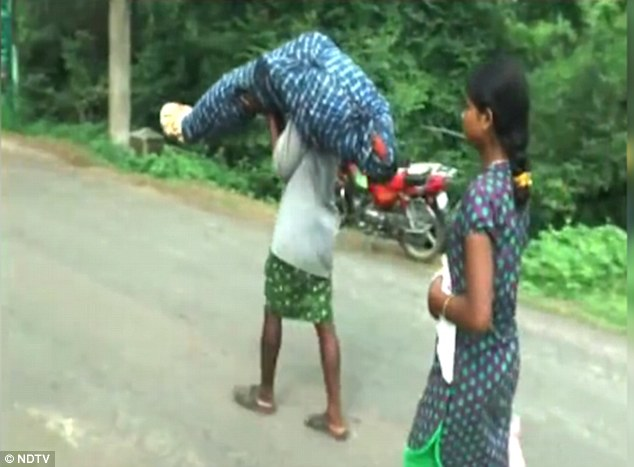 A man carries his sick wife to the hospital as a landslide block road and she dies on the way: Maharashta